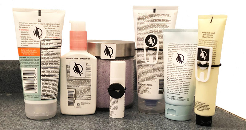 Beauty care products in a line with WayTags on each product