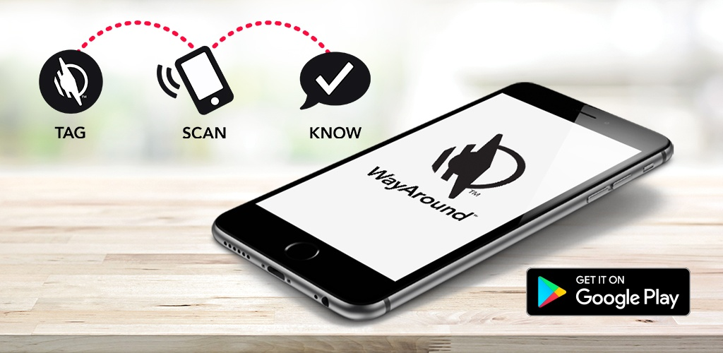 Smartphone with WayAround logo on the screen laying on a wooden counter. THree icons say tag, scan, know. Black rectangle says Get it on Google Play