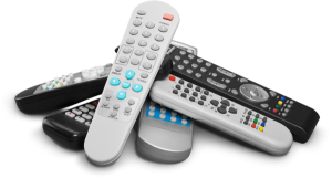 Photo of six remote controls stacked in a pile