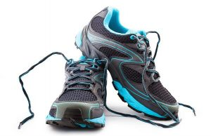 Grey running shoes unlaced with teal blue accents