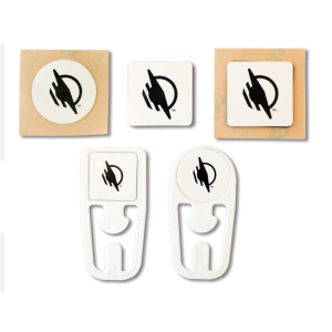 A group of five WayTags, including a round sticker, square magnet, square sticker, square top WayClip and round top WayClip.