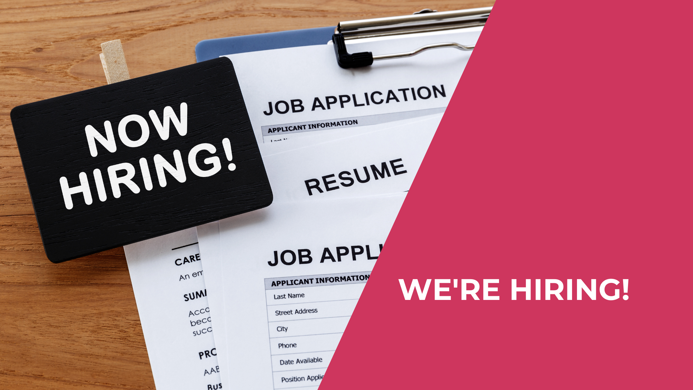 Bold sign reads Now Hiring. It sits atop a clipboard with papers that say Job Application and Resume. Text reads We're hiring.