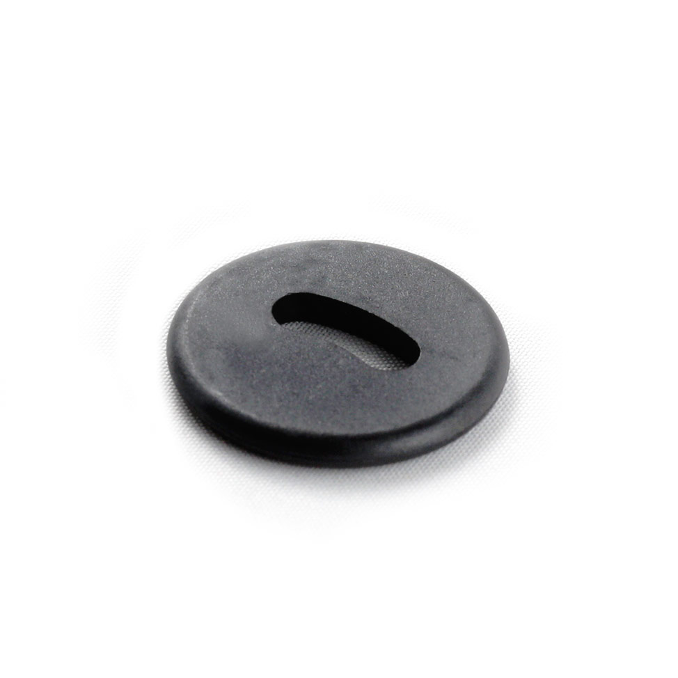 Front side of a black oval hole button