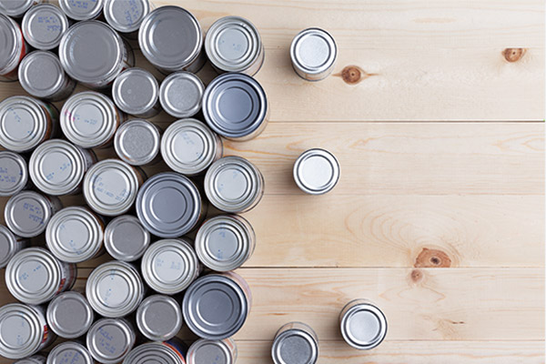 Many different sizes of canned goods, viewed from the top.