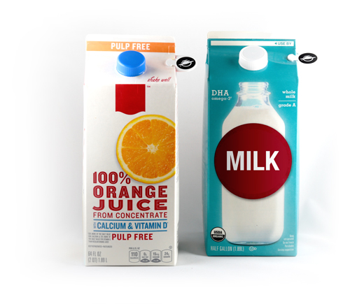 An orange juice carton and a milk carton of the same size and shape each with a WayClip attached to it.