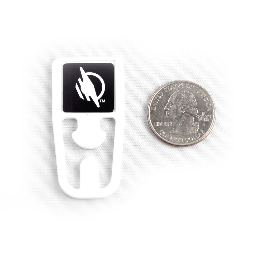 Square top WayClip next to a quarter, showing that it's about the size of two quarters placed next to each other