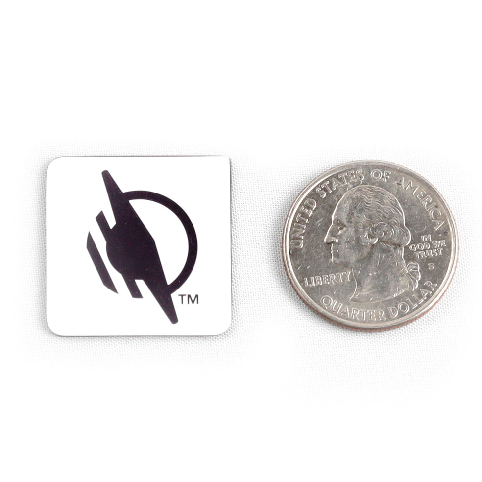 Square WayTag magnet next to a quarter. The quarter is about the same width and height as the magnet.