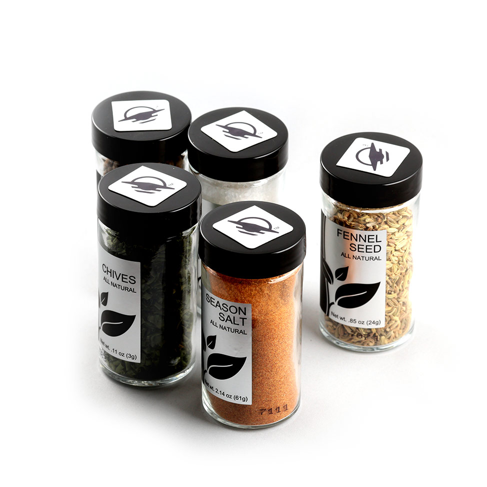Square WayTag magnets attached to the tops of five spice shakers