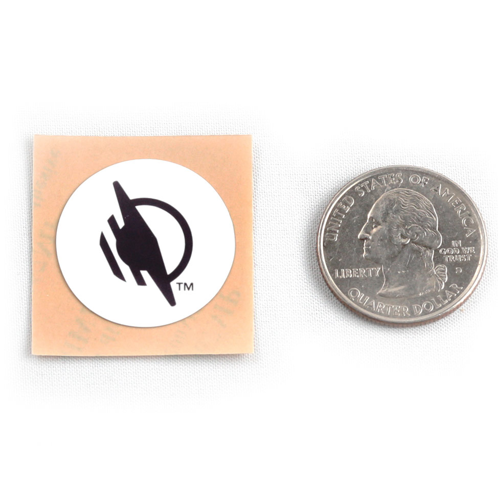 Round WayTag sticker next to a quarter. The quarter is about the same width and height as the sticker.