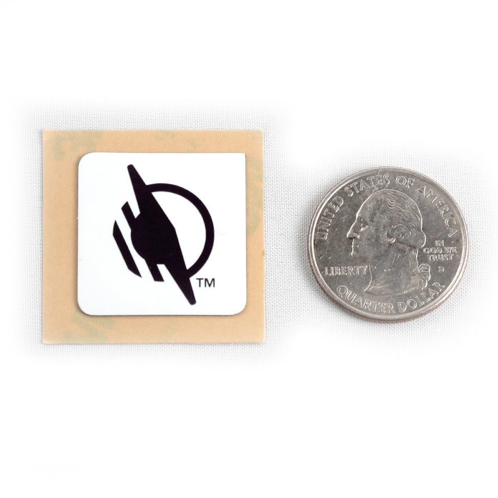 Square WayTag sticker next to a quarter. The quarter is about the same width and height as the sticker.